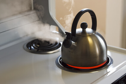 Steaming Tea Kettle on Stove Top