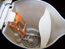 Inside image of an electric kettle with limescale